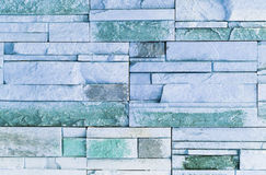 Blue stone wall. Front view of blue stone wall Stock Image