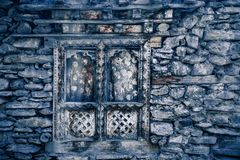 Blue stone wall with wood window. Background. Royalty Free Stock Image