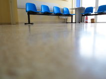Blue stools in the waiting room Stock Images