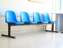 Blue stools in the waiting room Royalty Free Stock Photos