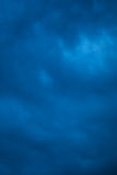 Blue Storm Texture. A deep blue background of storm clouds in the evening Stock Image