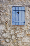 Blue strand with heart on wall Royalty Free Stock Photos