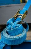 Blue Strap and Ratchet. On a truck deck Royalty Free Stock Photo