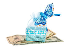 Blue straw bag with money and butterfly. Stock Photography