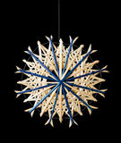 Blue straw star Christmas decoration over black Stock Photos