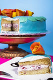 Blue strawberry layer cake. Slice of a creamy strawberry cake on blue background Royalty Free Stock Photography