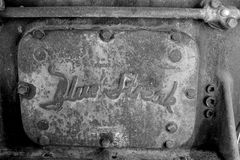 Blue Streak 6-Cylinder Gasoline Engine Plate. Black and white image of vintage plate on a Blue Streak 6-Cylinder engine in a snowblower that cleared the snow on Royalty Free Stock Images