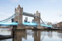Blue streak of lights passing through London Bridge Stock Images