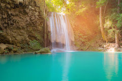 Blue stream natural waterfall in tropical deep forest Royalty Free Stock Images