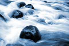 Blue stream with rapids Stock Image