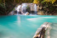 Blue stream water falls locate in deep forest jungle Stock Photos