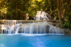 Blue stream waterfall in deep forest national park Royalty Free Stock Images