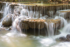 Blue stream waterfall in deep forest of Thailand Stock Images