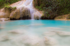 Blue stream waterfall with small lake locate in national park Stock Photo