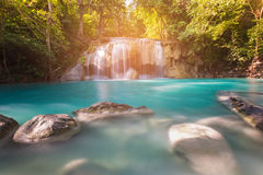 Blue stream waterfall in tropical deep forest Royalty Free Stock Image