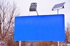 Blue Information stand in city. Blue street billboard poster stand in urban park Royalty Free Stock Photography