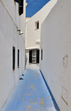 Blue street between white houses, Minorca, Spain stock photos