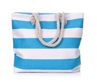 Blue striped beach bag. Isolated on white Stock Images