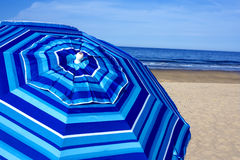 Blue striped beach umbrella Royalty Free Stock Photography