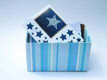 Blue striped box with cards  Royalty Free Stock Photos