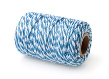 Blue striped cotton bakers twine spool. Isolated on white royalty free stock photo