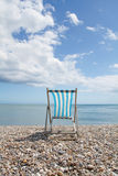 Blue striped deckchair Stock Photos