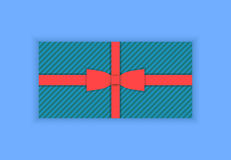 Blue striped gift with red ribbon and bow, flat. Blue striped gift with red ribbon and bow stock illustration
