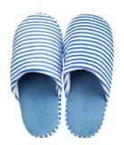 Blue striped slippers isolated on white background. Close up, high resolution Stock Photos