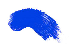 Blue stroke of the paint brush. On white paper Stock Images