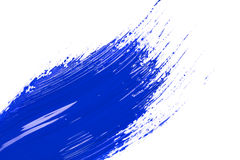 Blue stroke of the paint brush. On white paper Royalty Free Stock Photos