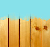 Blue stroke of paint brush on wooden background Stock Image
