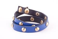 Blue studded bracelet Stock Images