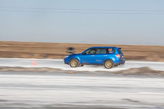 Blue subaru Forester on ice track. Moscow, Russia - March 1st, 2014: Moscow Subaru Forester club championship. This stage was located in Moscow, on the frozen Royalty Free Stock Photography