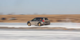Blue subaru Legacy on ice track. Moscow, Russia - March 1st, 2014: Moscow Subaru Forester club championship. This stage was located in Moscow, on the frozen pond Royalty Free Stock Photography