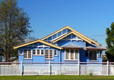 Blue suburban Australian home. A view of a neat blue suburban family home with a white fence on a bright cloudless day in Brisbane, Australia Stock Photography