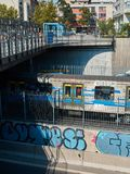 Blue Subway train with graffiti stock photo