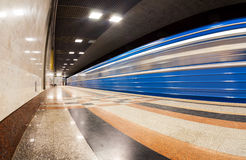 Blue subway train in motion Stock Image