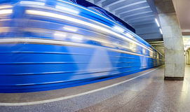 Blue subway train in motion at the underground station. Wide ang Stock Photos