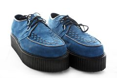 Blue Suede Shoes. A pair of mens retro creeper-style shoes in blue suede with a two inch sole and black chequer/checker design on the top. Favoured by men who royalty free stock photography
