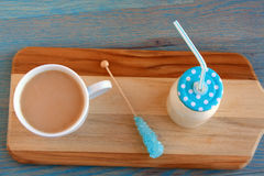 Blue Sugar stick jug of milk next  a and mug of coffee Stock Photos