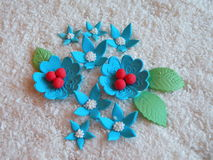 Blue sugary flowers. Different shape blue  artificial sugary flowers on coconut shavings Stock Images