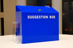 Blue suggestion box. In an office royalty free stock image