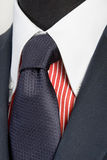 Blue suit with tie and red striped shirt Stock Photography
