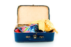 Blue suitcase with clothes. On white background stock photo