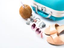 Blue suitcase, coconut, sandals, sun glasses Stock Photos