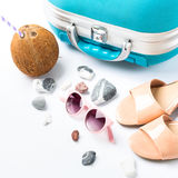Blue suitcase, coconut, sandals, sun glasses Royalty Free Stock Image