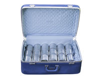 Blue suitcase with metal tins Royalty Free Stock Photos