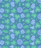 Blue summer floral pattern with clover Stock Photos