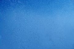 Blue summer raindrops falling Stock Photo