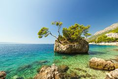 Blue summer sea with shiny sky and rocks, holiday landscape Royalty Free Stock Image